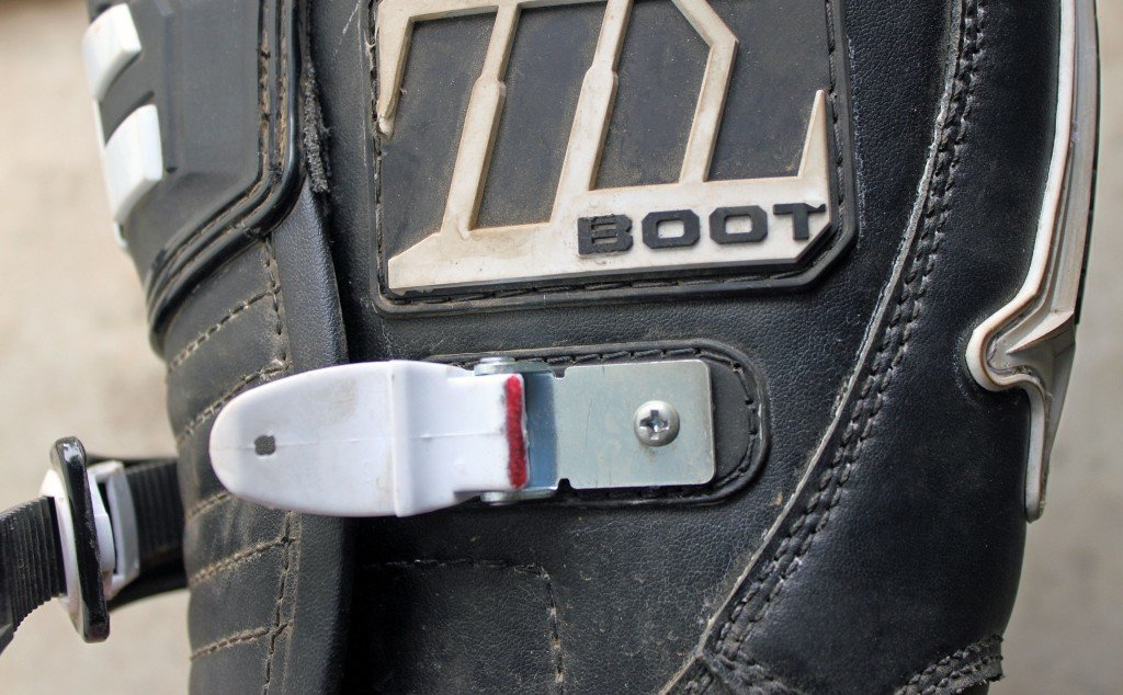 GENTLY FILING A SMALL AMOUNT OF MATERIAL OFF THE AREA MARKED IN RED GREATLY IMPROVED THE BUCKLE ACTION OF THE m1.2
